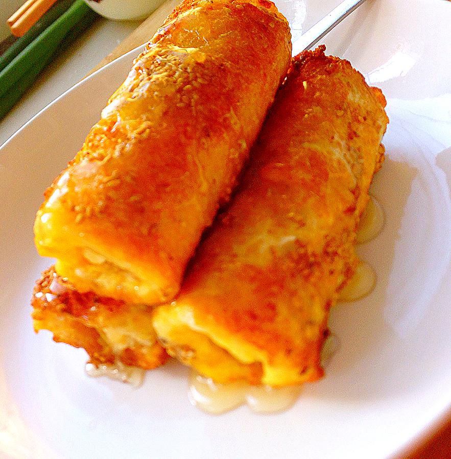 吐司 香蕉 鸡蛋 白芝麻 蜂蜜 简单易学早餐——吐司香蕉卷的做法步骤