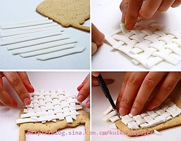 编花篮体,花篮体用的编织法,用白色的糖皮,擀平后切成均一的细条,然后